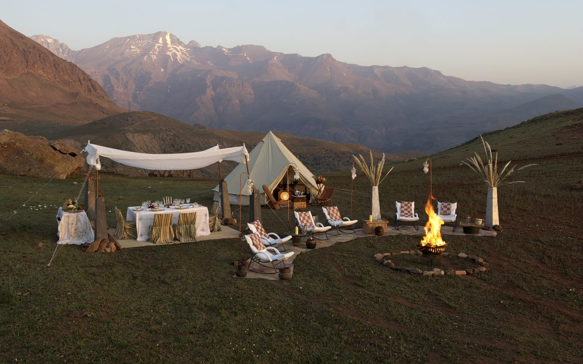 Tee pee tent with tables set up in nature