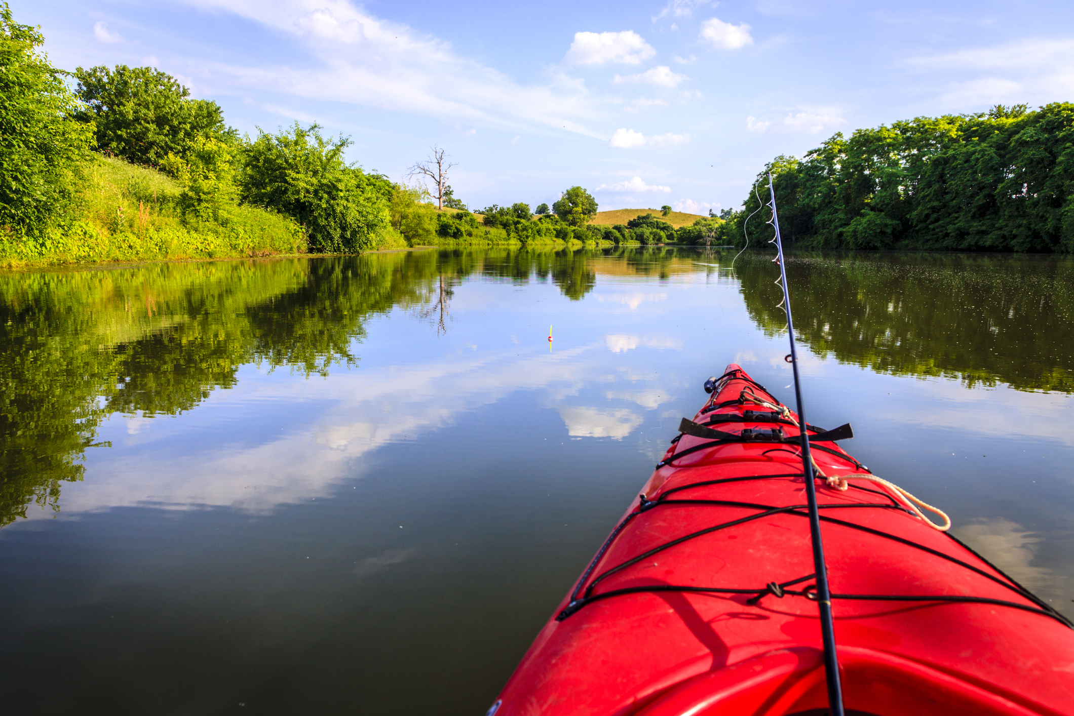 Gulf Coast Kayak Fishing — Red kayak wifh fishing poles
