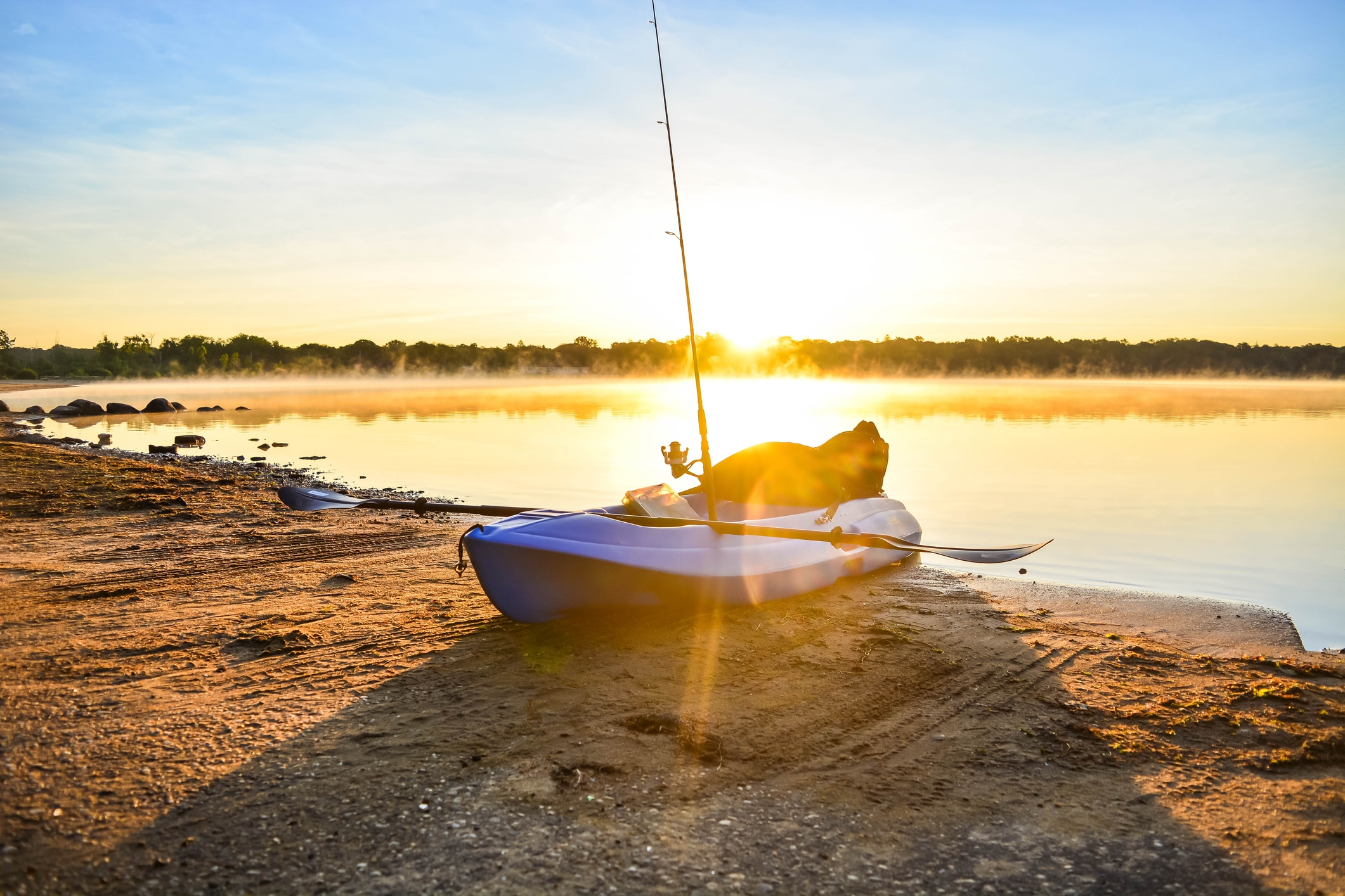 Kayak fishing during sunrise