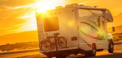 An RV under a hot desert sun.