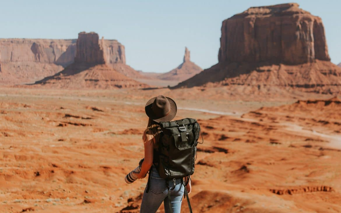 Woman backpacking Monument Valley