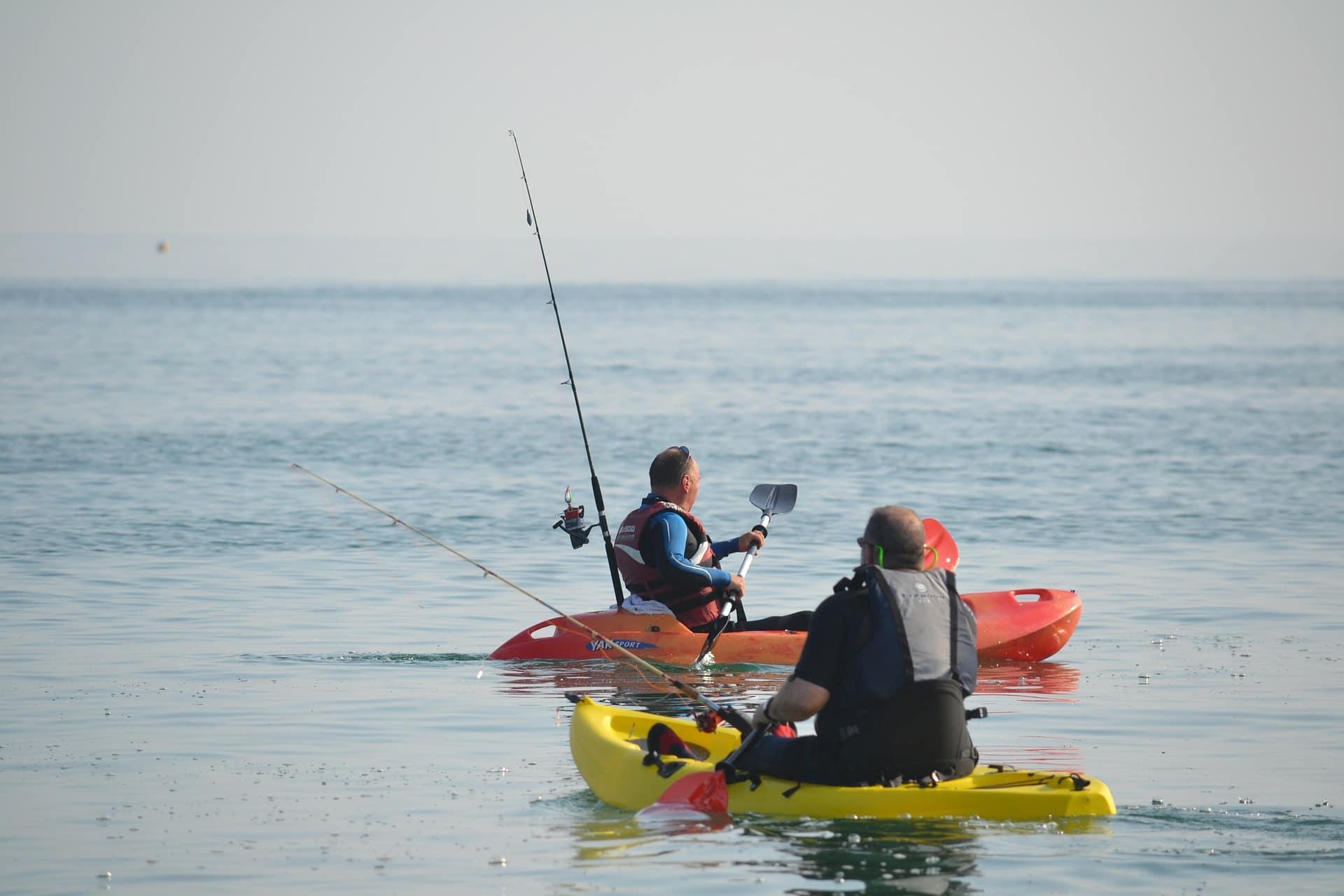 Tow men in kayaks fishing