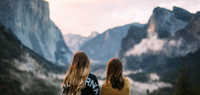 Two girls gazing at Tunnel View view