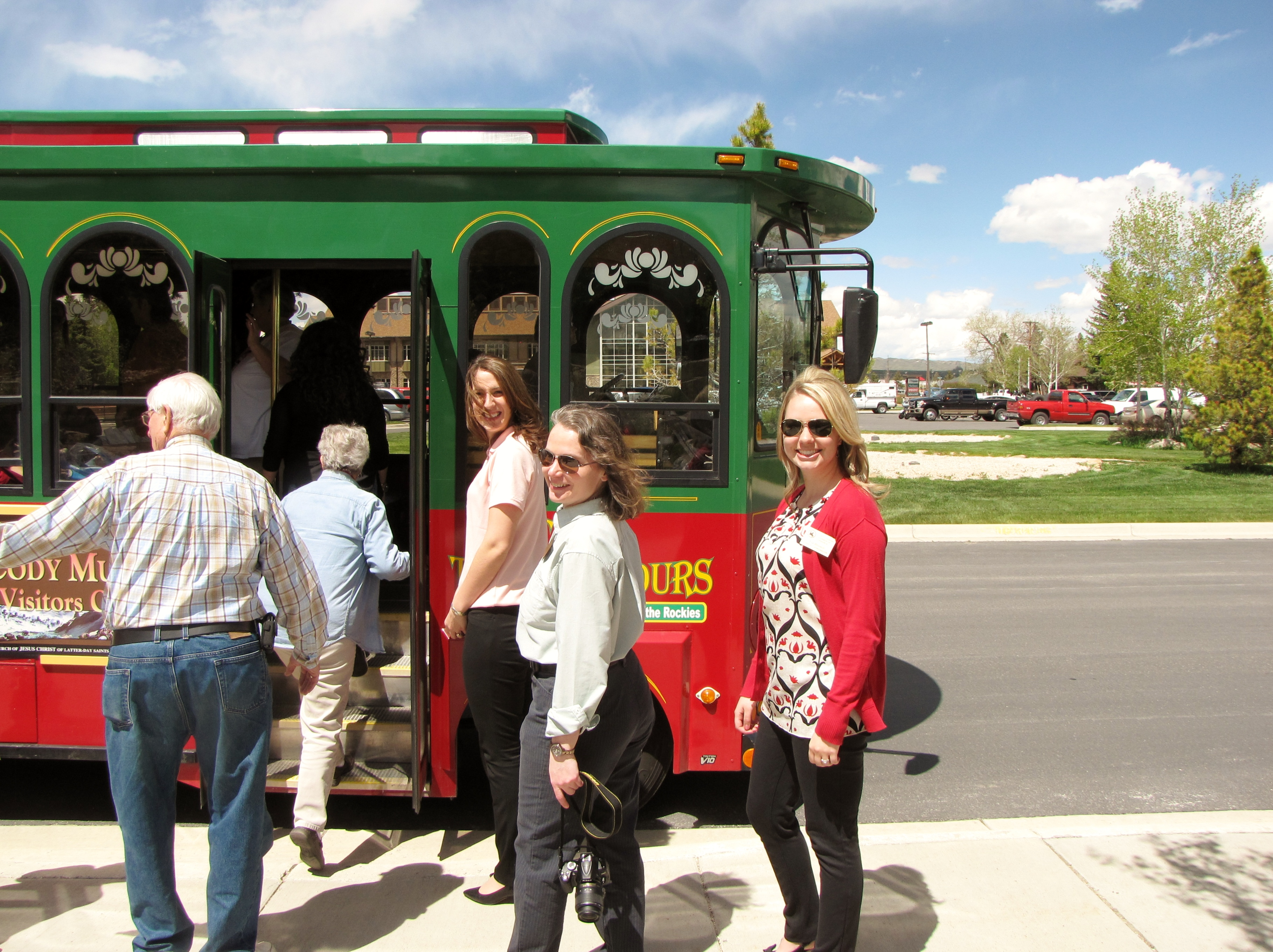 Cody in Wyoming —Passengers board a red and green trolley