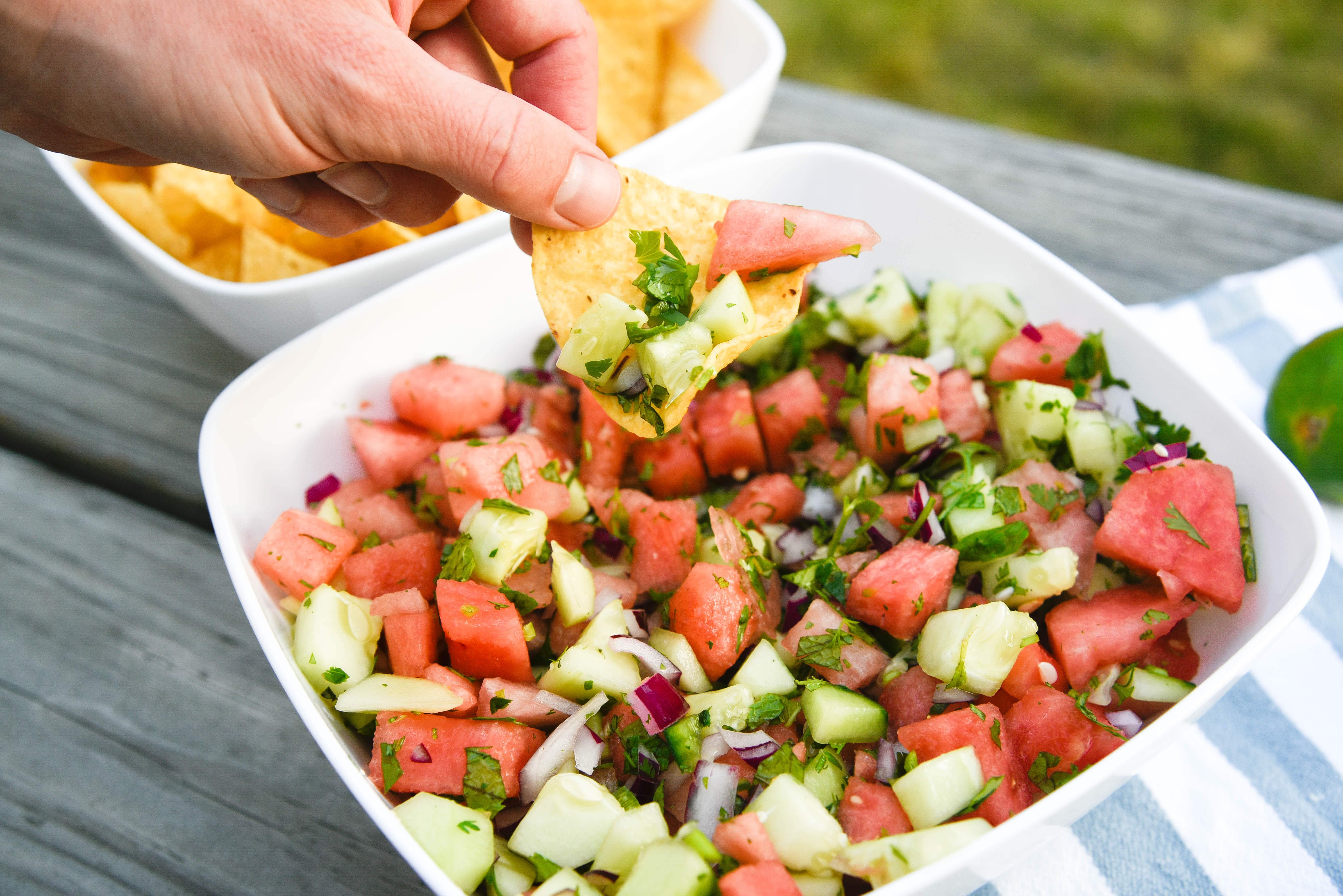 Chip scooping up watermelon salsa