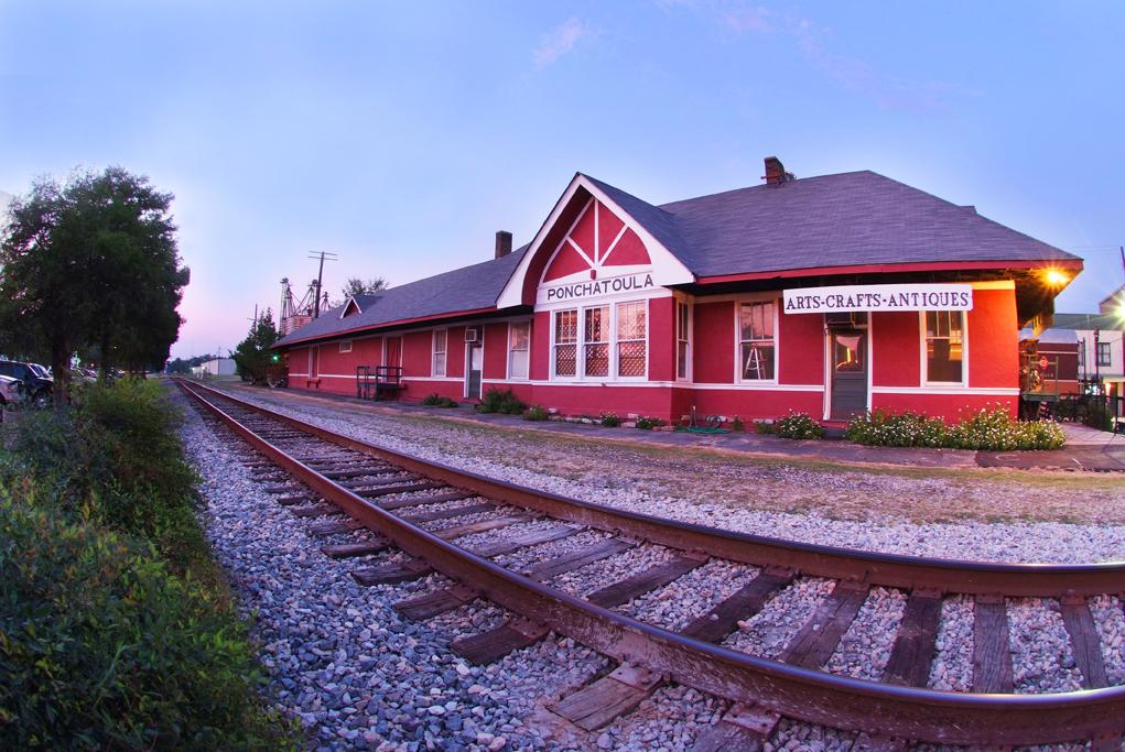Tangipahoa Parish offers a variety — Red building near railroad track