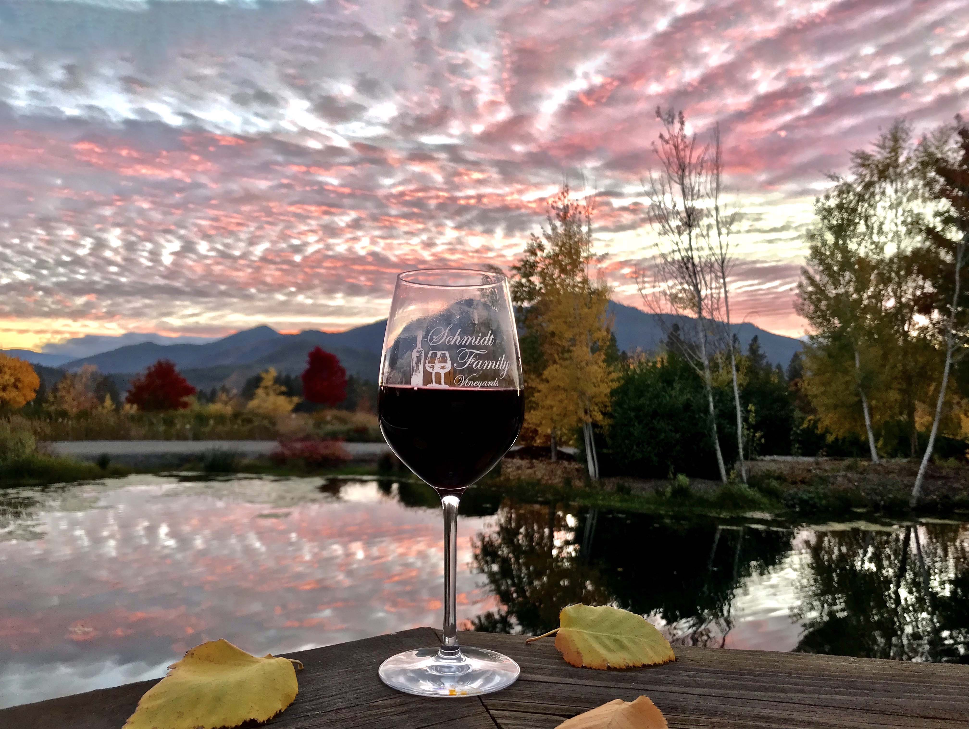 Southern Oregon — a glass of red wind against a sunset sky.