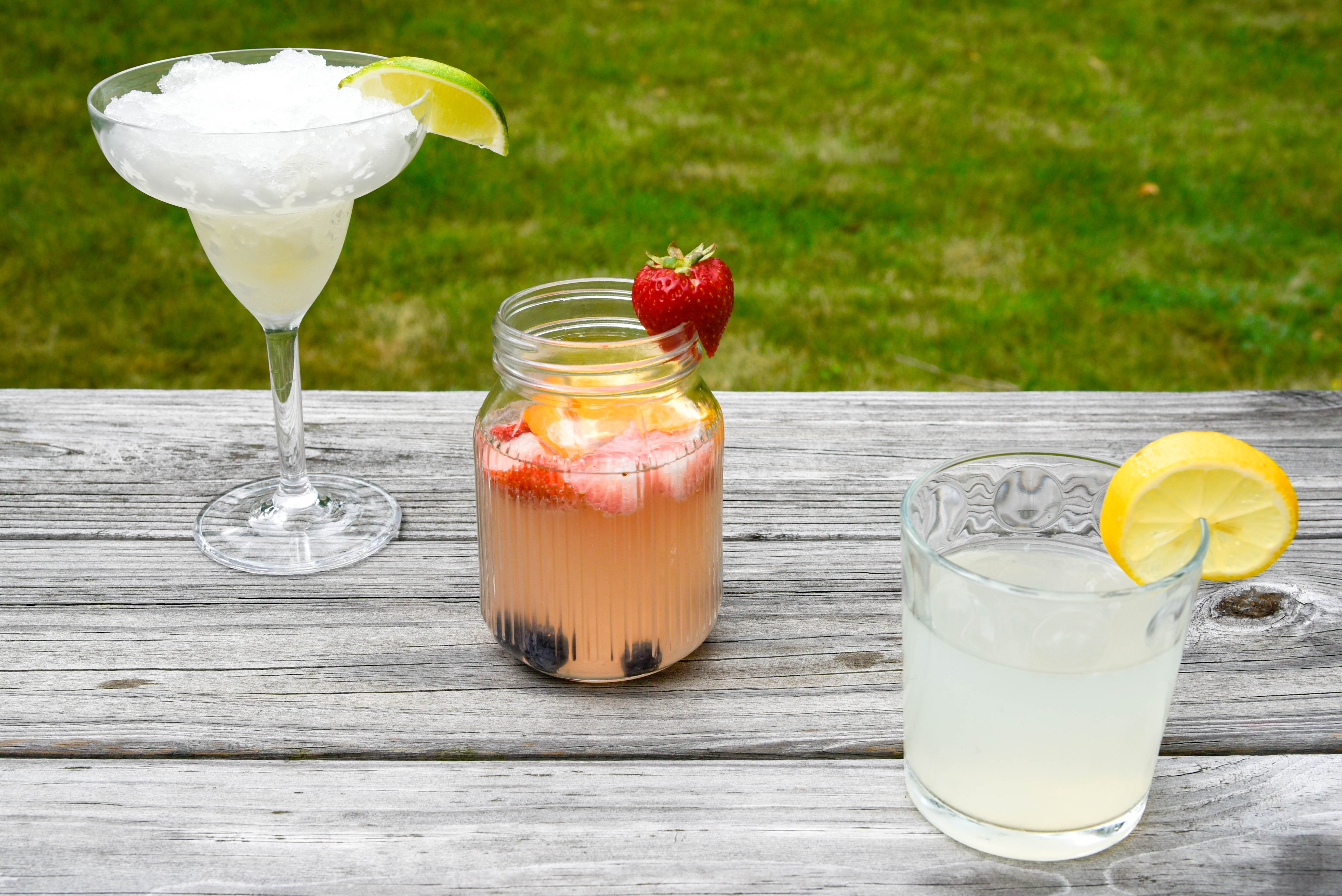 Camping Cocktails —three cocktails in diagonal pattern, each with fruit.