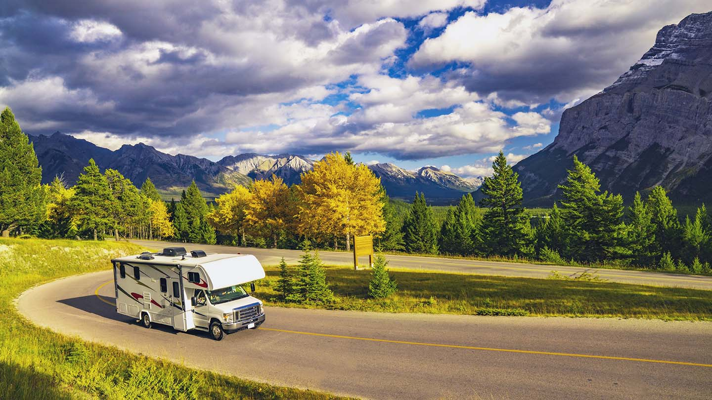 Recreational Vehicle Driving on Autumn Highway In Beautiful Mountains Wilderness in Jasper, AB, Canada