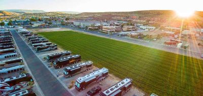 Sun sets over immaculate rows of motorhomes in an RV resort