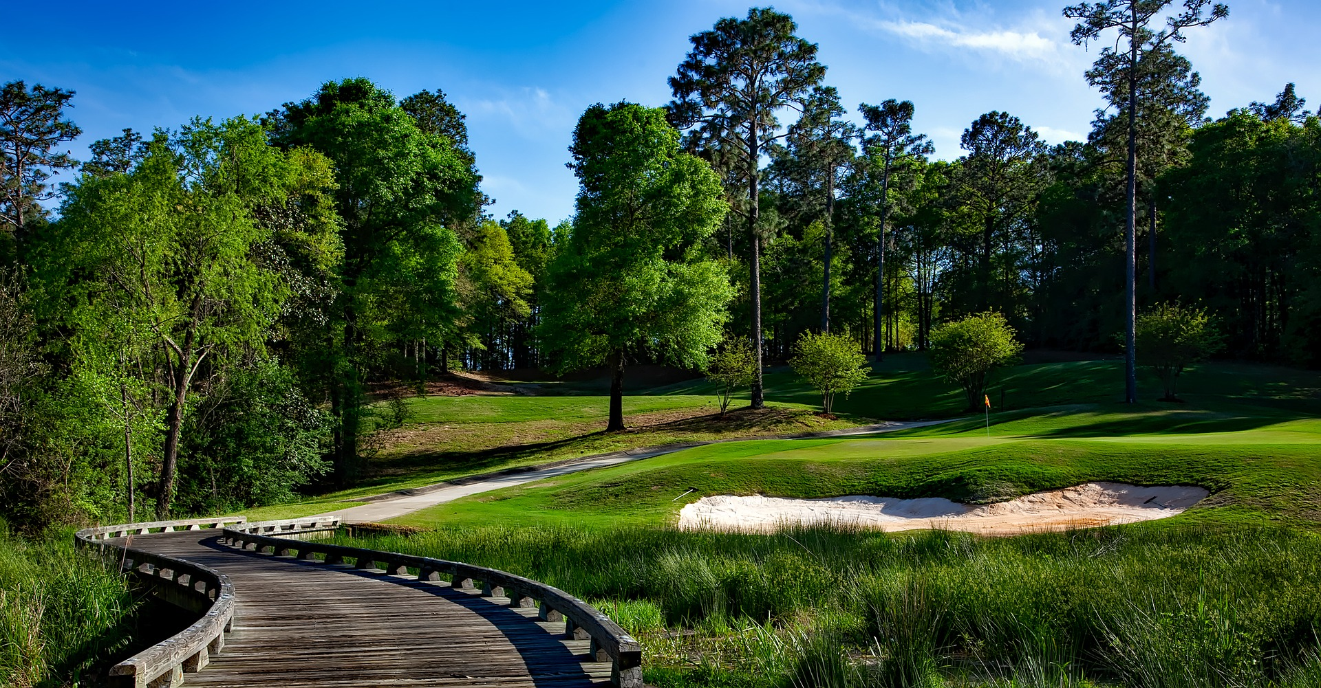 Golf course accessible with wooden walkway.
