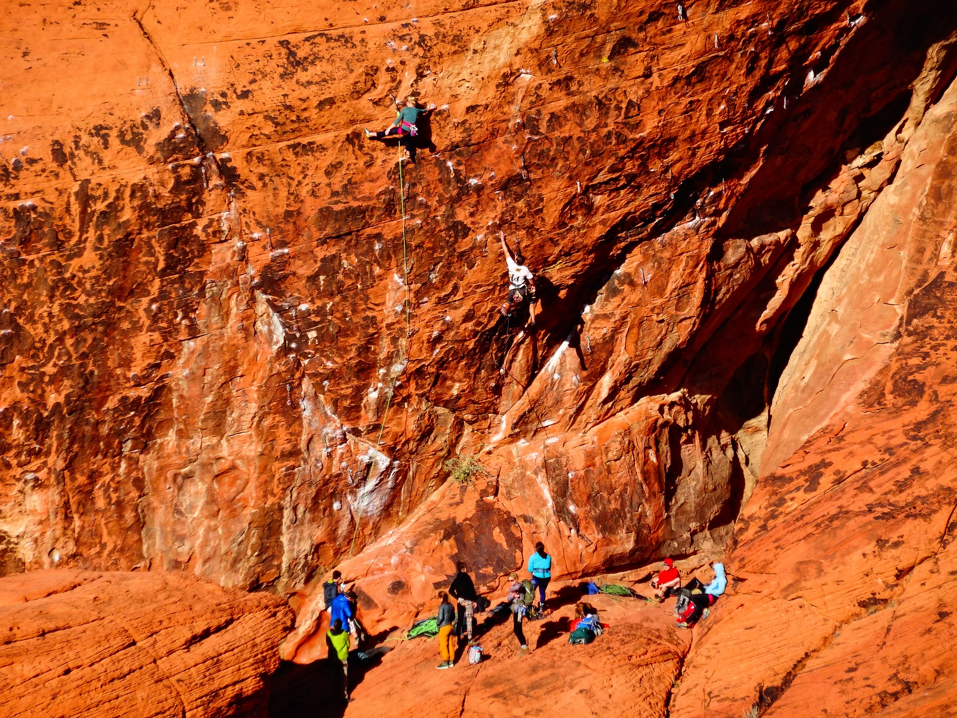 Climbers scale sheer red rocks