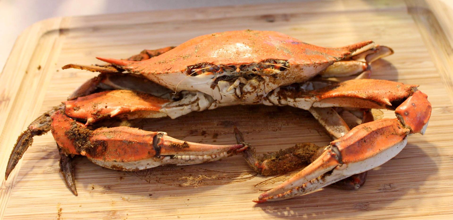 Steamed crab on cutting board.